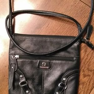 Etienne Signed cross body leather bag